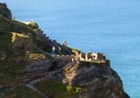 View of Tintagel Castle along the coast from St Materiana church